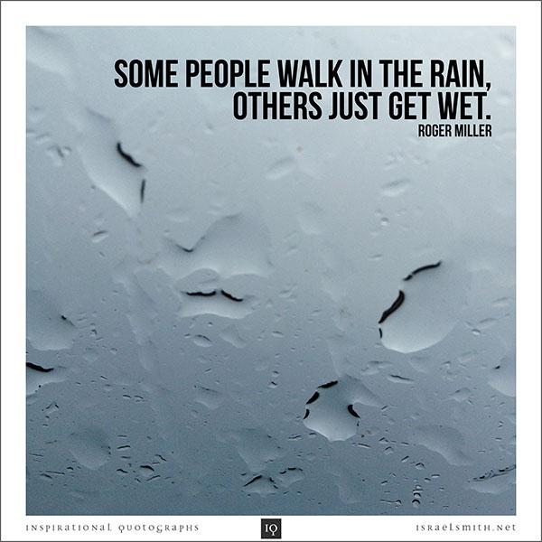 Some people walk in the rain